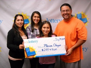 Marina Olague and her family after winning the Super Lotto